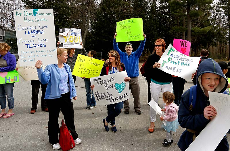 """Parents gather at the Fred P. Hall Elementary School on Thursday to show their support for teachers after the LePage administration gave the school an """"F"""" in its new state rankings."""