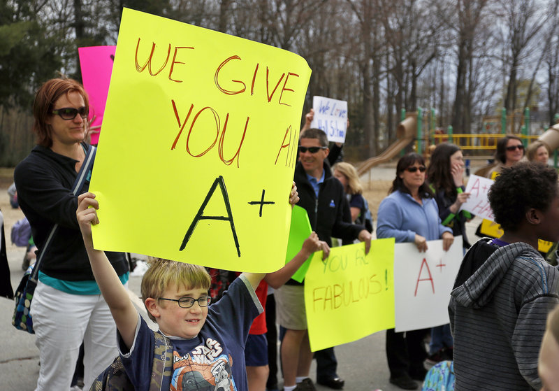 Hall Elementary School student Harrison Greene takes part in a rally Thursday in support of the Portland school, which received an F under a new state grading system. The grades don't reflect all that Maine schools have to offer, readers say.