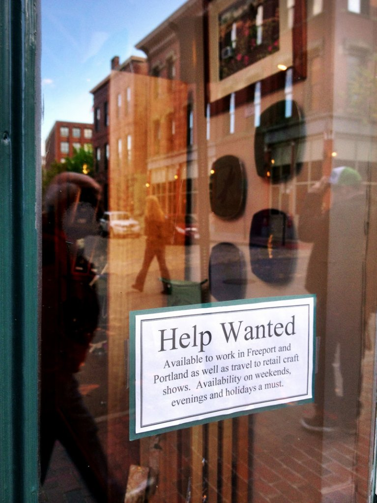 A help wanted sign on the door of Lovell Designs in Portland's Old Port hints of better unemployment numbers. Photographed on Friday, May 17, 2013.
