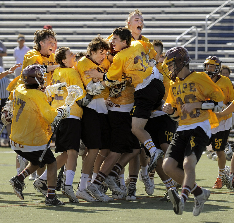 There was no holding back Cape Elizabeth for much of the season, and no holding the players back after they beat Yarmouth 7-4 to win the Class B boys' lacrosse title.