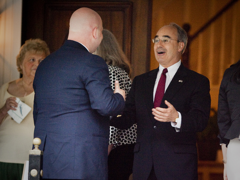 Bruce Poliquin, right, a former candidate for governor, chats with other guests outside the Nonantum Resort in Kennebunkport, where he was attending a fundraiser for Maine Gov. Paul LePage on Tuesday.