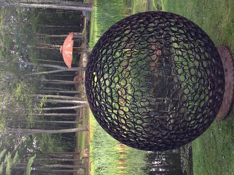 "Jay Sawyer has dotted his property in Warren with the sculptures that he creates from salvaged materials, including ""Samosphere IV: A Space for The Spirit."""