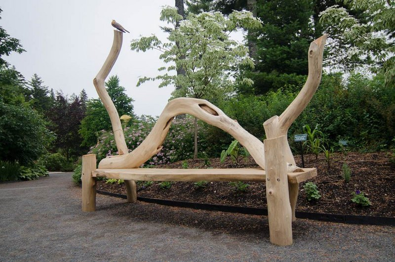 "At Coastal Maine Botanical Gardens in Boothbay: ""Black Locust Bench with Robin"" by Ray Carbone."
