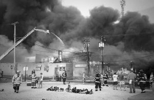 FIREFIGHTERS BATTLE a raging fire Thursday on the boardwalk in Seaside Heights, N.J., that apparently started in an ice cream shop.