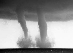 A PAIR OF WATER SPOUTS form on Lake Michigan southeast of Kenosha, Wis., on Thursday. The National Weather Service in Sullivan said the water spouts occurred about four miles southeast of Kenosha. A water spout is basically a tornado over water, meteorologist Ed Townsend said.