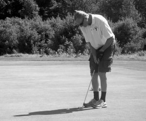 MARK WHEELER sinks a putt on one of the greens.