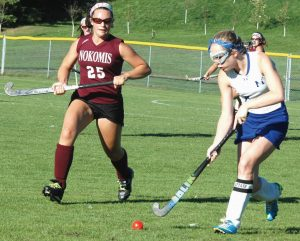 MORSE HIGH SCHOOL field hockey player Brittany Kaler (right,top photo) attempts to get past Nokomis forward Mikayla Charters in first-half KVAC action in Bath on Thursday. In the botom photo, Morse midfielder Kaylee Walker carries the ball up the field with Nokomis' Kirsten Costedio (25) closing in. The Warriors won, 6-0 to drop the Shipbuilders to 1-5 on the season.