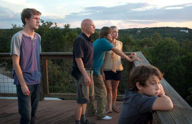 This Aug. 25, 2013 photo shows Steve Wolf, a self-employed stunt and special effects coordinator for film and television, who lives with his wife Maegan and their sons Clayton, 16, Paxton, 12, and Dashton, 8, in Austin, Texas. The Wolf family worries their income is too high to qualify for new tax credits implemented under the Affordable Care Act.