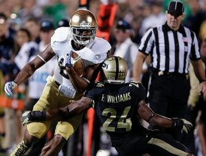 NOTRE DAME wide receiver C.J. Prosise, left, tries to get past Purdue defensive back Frankie Williams during the second half of an NCAA college football game in West Lafayette, Ind., on Saturday.