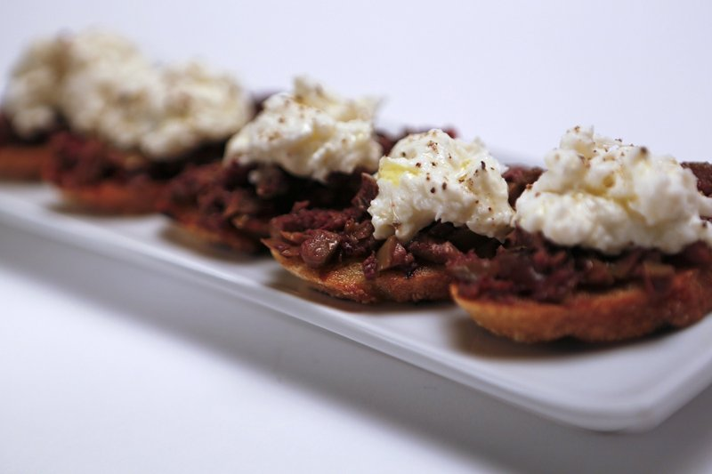 Bruschetta topped with burrata and tapenade