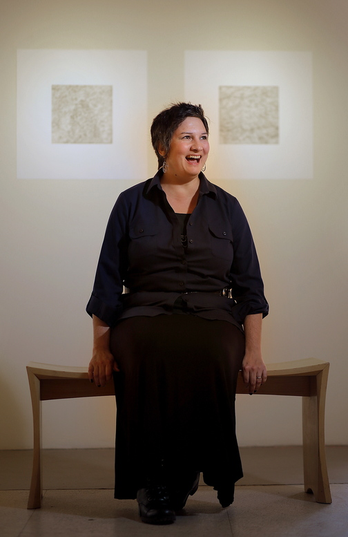 """Amy Stacey Curtis in the June Fitzpatrick Gallery on Congress Street in Portland, where her drawings of 99 things in her home are exhibited. The Portland Museum of Art also is exhibiting work by Curtis, """"9 Walks,"""" nine videos that are part performance, part installation."""