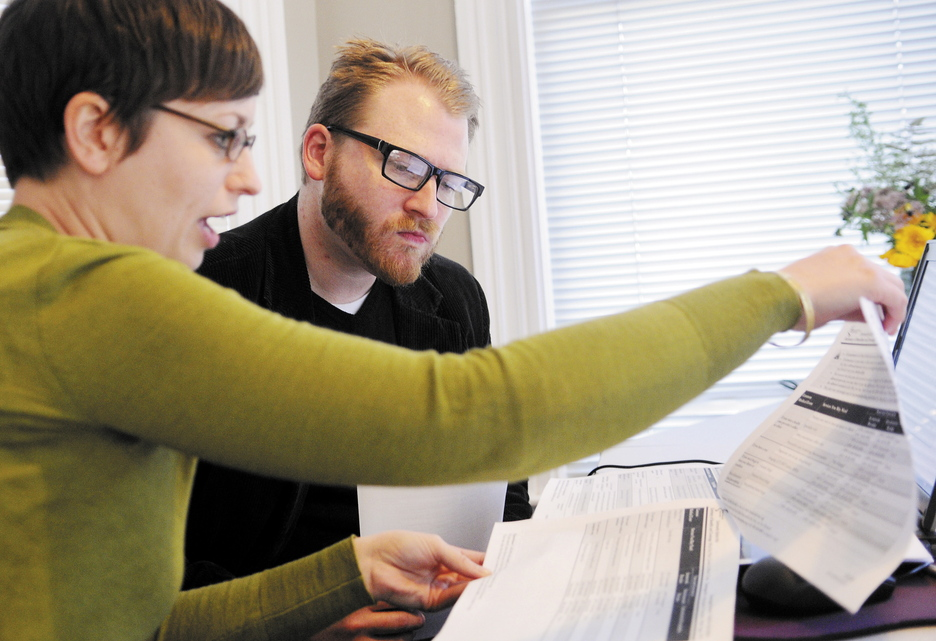 Emily Brostek, left, assists Jesse Miller of Portland to learni about health insurance options under the Affordable Care Act on Tuesday October 1, 2013. Brostek works at the Consumers for Affordable Health Care offices in Augusta.