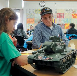 KOREAN WAR veteran George McConnon, above, tells students about life in a battle tank with five other soldiers.