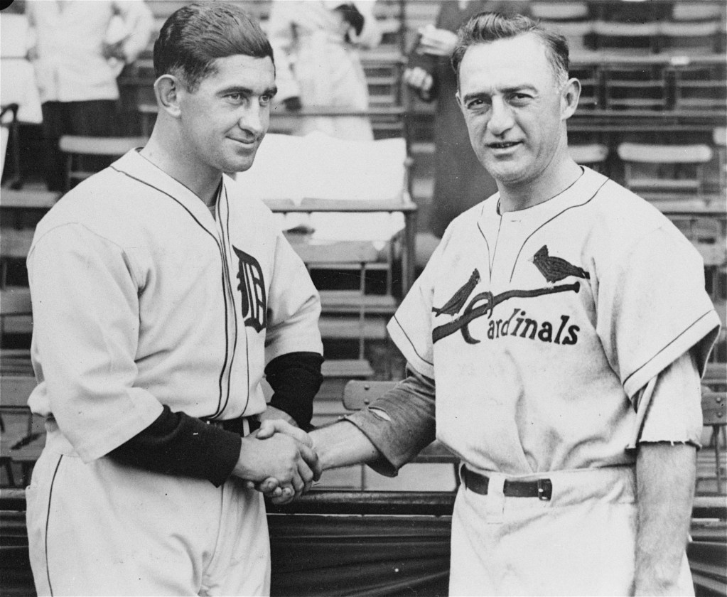 Detroit Tigers manager Mickey Cochrane, left, and St. Louis Cardinals manager Frankie Frisch shake hands before the start of the opening game of the World Series in Detroit.
