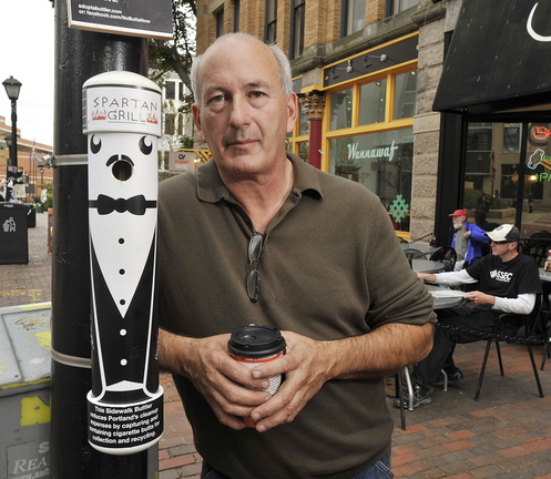 Mike Roylos, owner of the Spartan Grill restaurant in Portland's Monument Square, has 10 of his Sidewalk Buttlers in the downtown area, including this one near his restaurant.