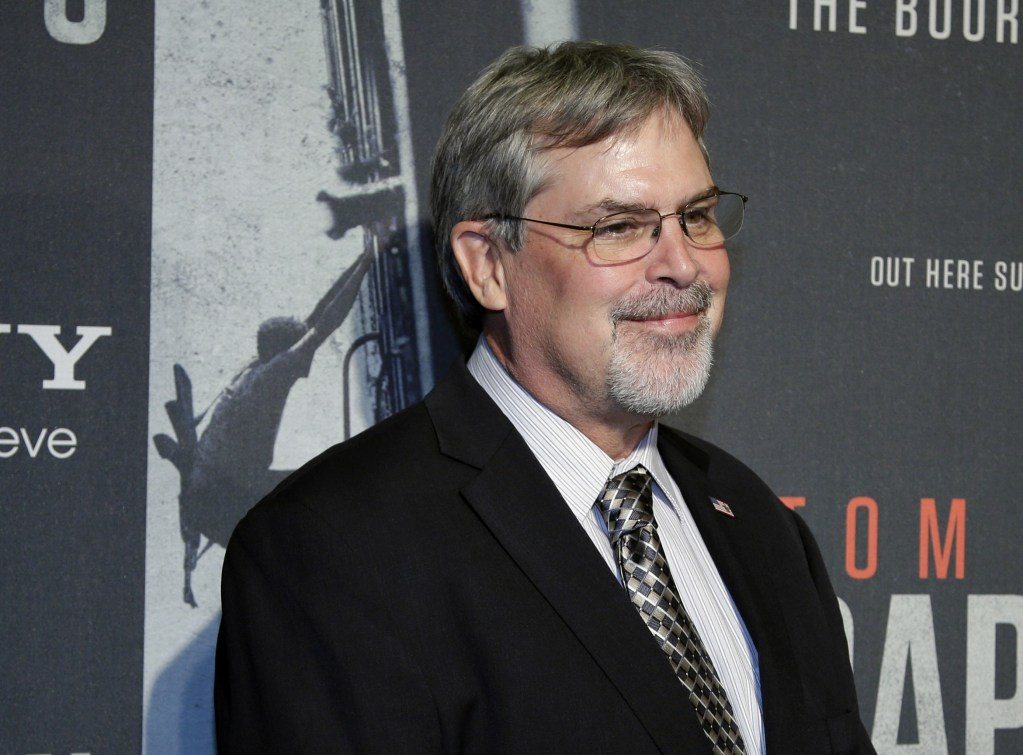 """In this Oct. 2, 2013, photo, Capt. Richard Phillips, arrives for the screening of """"Captain Phillips"""" at the Newseum in Washington."""