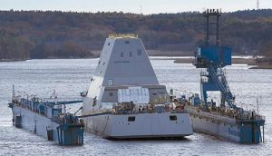 THE FIRST-IN-CLASS ZUMWALT, the largest U.S. Navy destroyer ever built, floats off a submerged dry dock into the Kennebec River on Monday night in Bath.