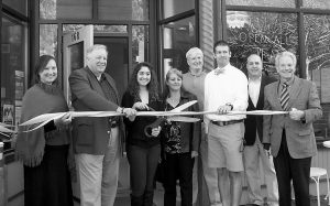 TOP IT FROZEN YOGURT BAR celebrated the official grand opening of its new retail location at 168 Main St. in Auburn. From left, are Regional Image Committee Chairwoman Hillary Dow; Lewiston Mayor Robert Macdonald; owner Corrie Bernatchez; owner of Maine Gourmet Chocolates Stephanie Bernatchez; Community Concepts business loan officer Joe Balchunas; Auburn Mayor Jonathan LaBonte; Auburn Economic Development specialist Alan Manoian; Androscoggin County Chamber of Commerce President Chip Morrison.