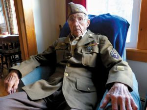 """LORING """"LARRY"""" EDGERLY, a World War II veteran, poses at his Woolwich home Wednesday. Edgerly will be honored Monday during a Veterans Day observance at Nequasset Meetinghouse in Woolwich."""