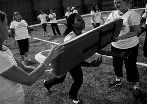PARTICIPANTS, including Jennifer Roebuck, of Richton Park, Ill., receive instruction on how to safely tackle during a safety clinic hosted by the NFL and the Chicago Bears for the mothers of youth football players in this Oct. 29, 2013 file photo taken at Halas Hall in Lake Forest, Ill. The 90-minute presentation is jointly sponsored by the local NFL team and the league, part of a charm offensive launched to combat the growing body of science on the dangers posed by concussions to even the youngest players.