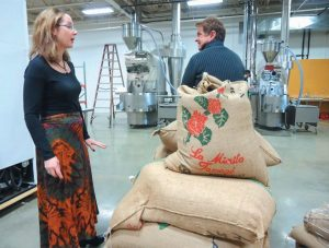 COFFEE BY DESIGN owners Mary Allen Lindemann and Alan Spear survey their new headquarters in Portland's East Bayside.
