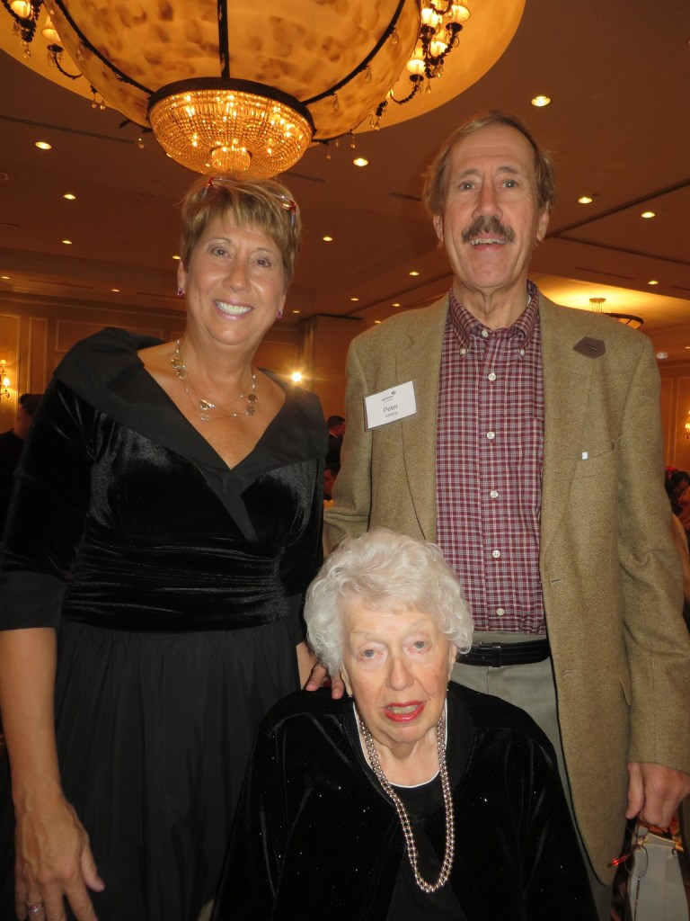 Meredith Strang Burgess, the 2014 Girl Scouts of Maine Woman of Distinction, with her mother Charlene Strang of Topsham and her brother Peter Strang, visiting from Florida.