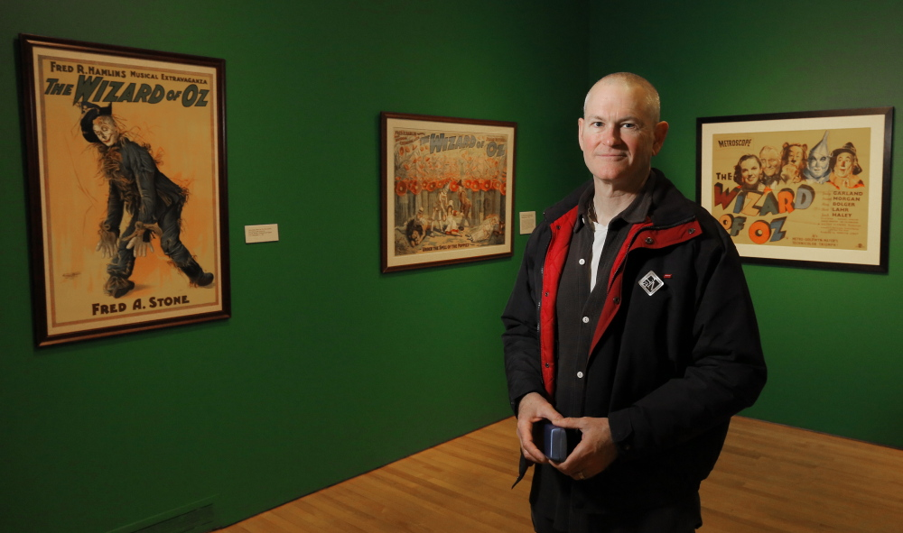"""Willard Carroll of Camden poses for a portrait among """"The Wonderful World of Oz: Selections from the Willard Carroll/Tom Wilhite Collection"""" at the Farnsworth Art Museum."""