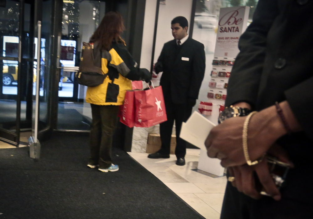A security agent checks the bags of a shopper at Macy's in New York. Claims of racial profiling at department stores in New York have helped expose the practice in more than 40 states of retailers holding shoplifting suspects and assessing fines, even if a person hasn't yet technically stolen anything. At Macy's flagship store, suspects are held in cells, asked to sign an admission of guilt and pay hundreds in fines.