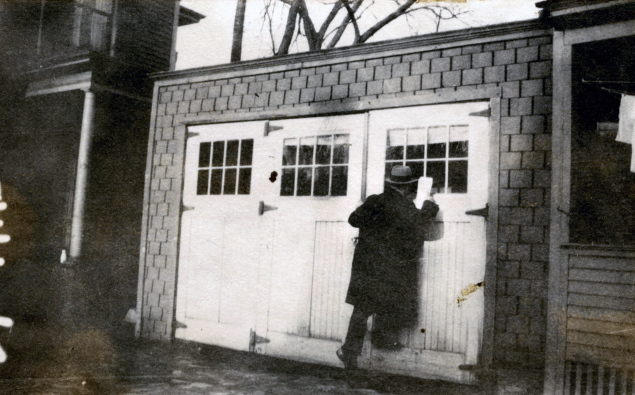 A city assessor is caught on film as he peers through a window of a garage at 29 Pine St. in Portland's West End.