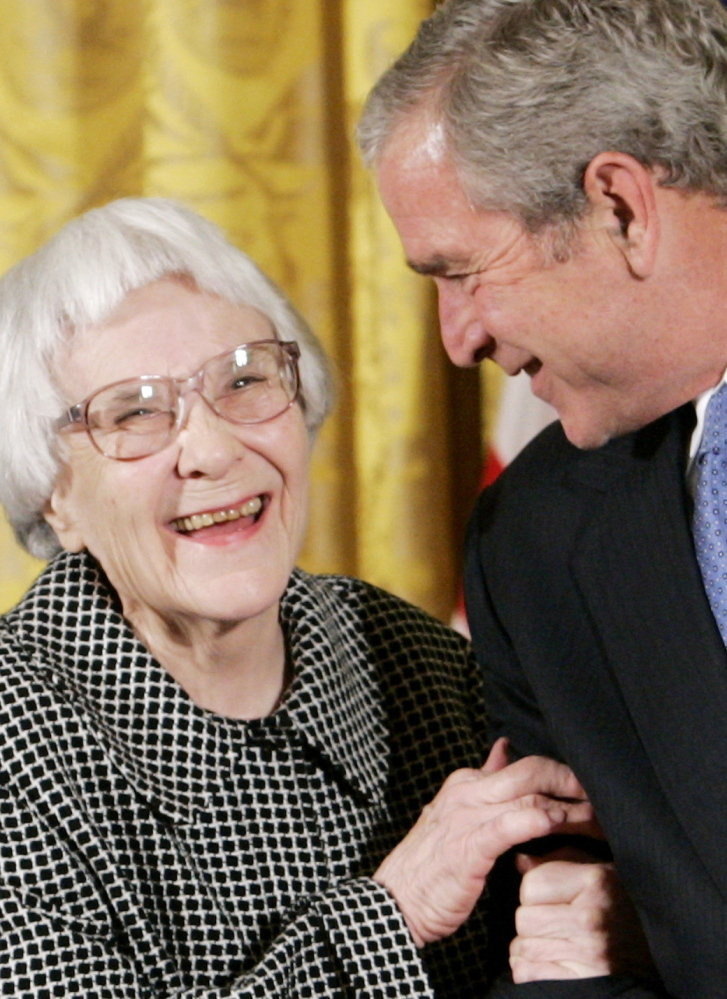 """President George W. Bush greets Harper Lee in 2007. Her """"To Kill a Mockingbird"""" is considered a modern classic."""