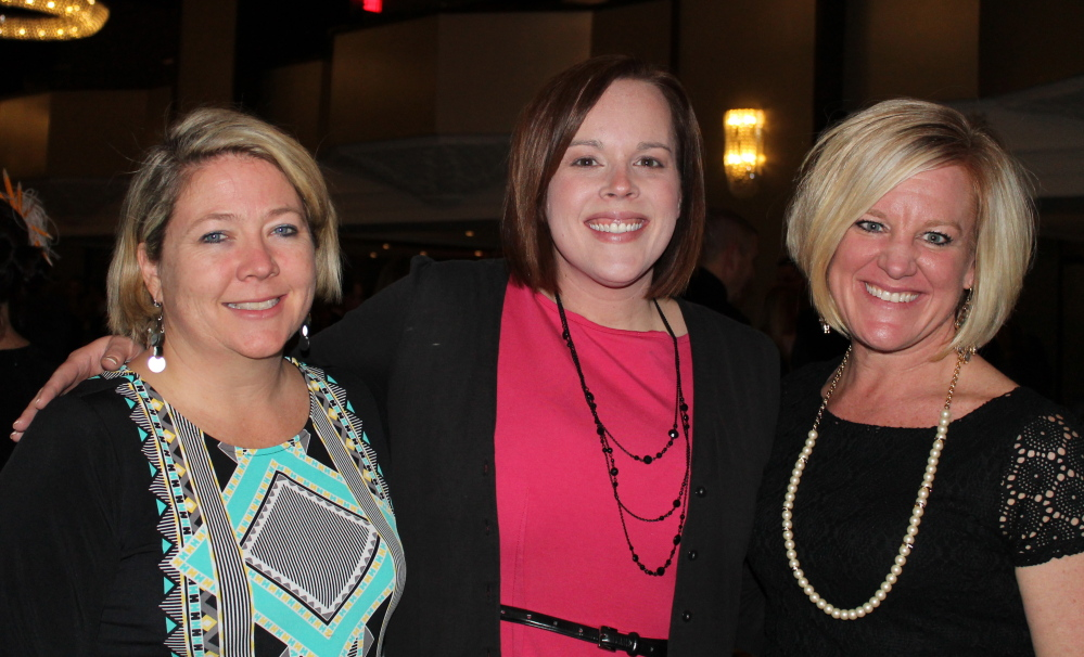 Junior League board member Kate Anderson, left, with Laura Heckman of Unum and Amy Cunniffe of Lincoln Financial Group.