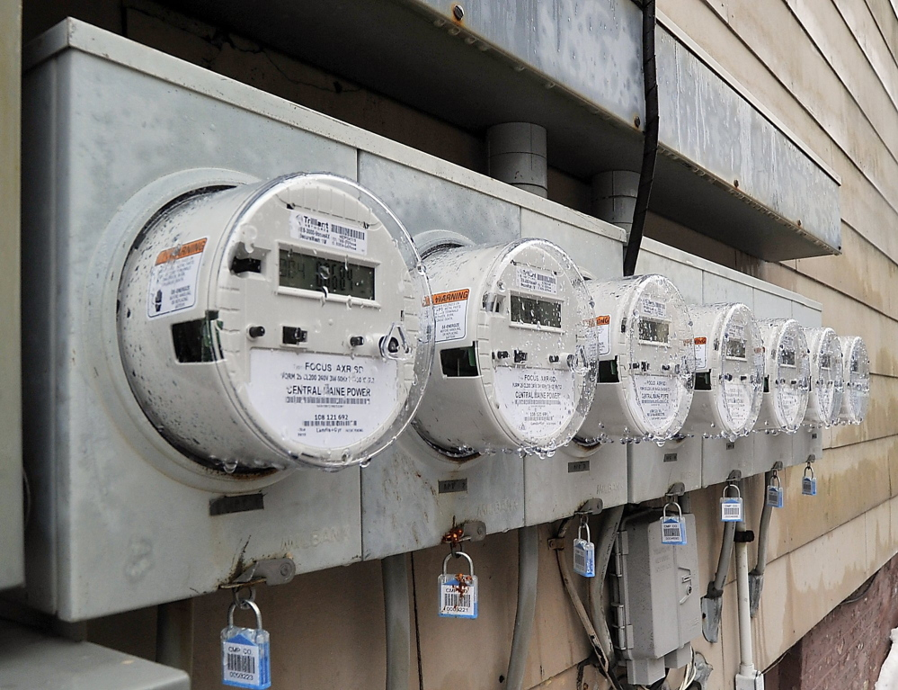 Seven smart meters measure electricity usage on an apartment building in the Western Prom area of Portland. Critics say the radio-frequency emissions can harm human health.
