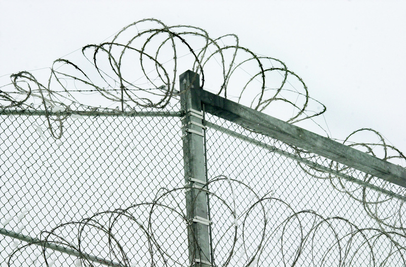 Razor wire is coiled at the top of the security fence at the Maine State Prison facility in Warren. A PBS documentary on solitary confinement in the U.S. will include Maine's progression on reducing its use.