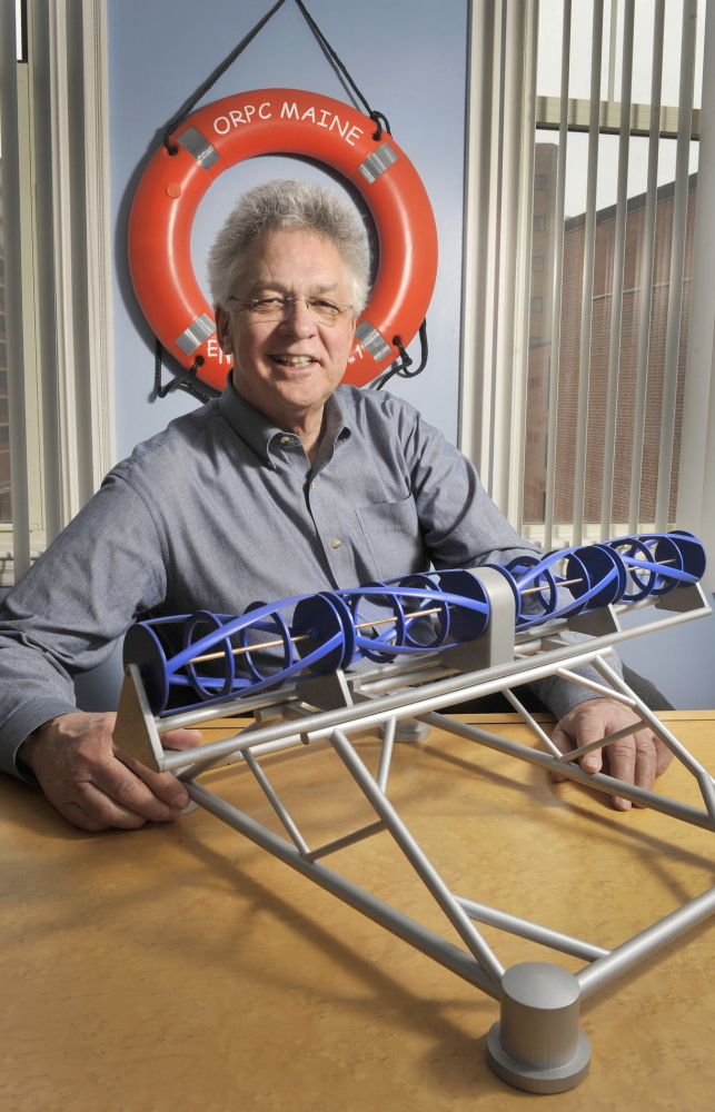 Chris Sauer, founder of Portland's Ocean Renewable Power Co., sits with a model of the company's TidGen power system, which was installed off Eastport and started generating power to the grid in 2012.
