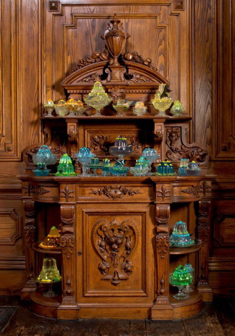Dozens of fancy gelatin resin sculptures by Mark Dion and Dana Sherwood populate cupboards in the Victoria Mansion dining room.