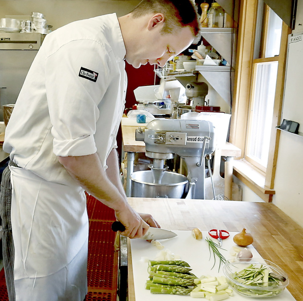 Joshua Mather, chef and owner of Joshua's Restaurant and Bar, preps the vegetables for asparagus soup.