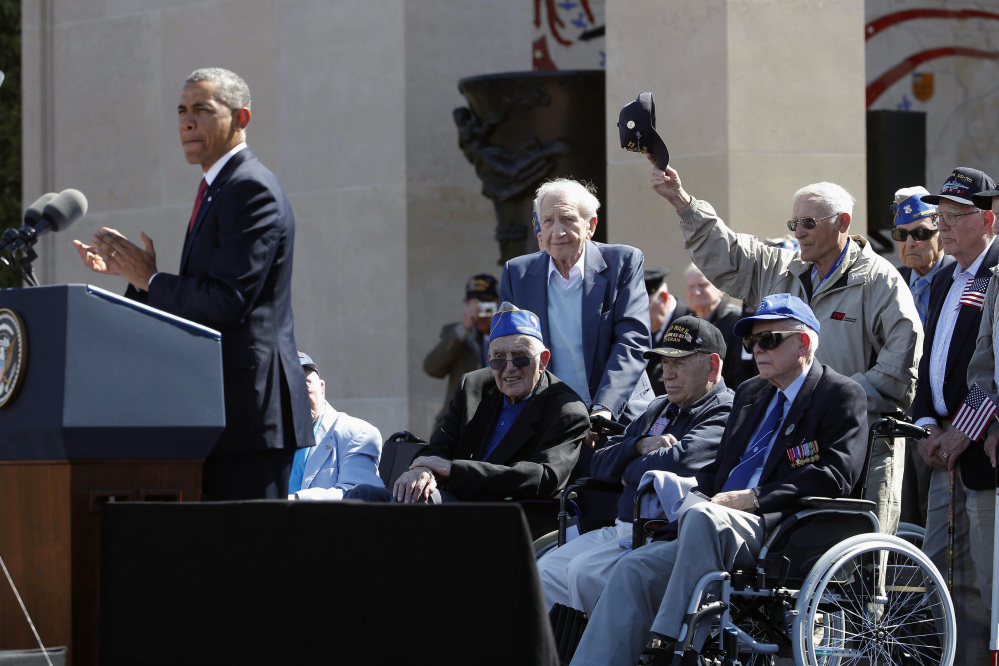 The Associated Press President Barack Obama acknowledges veterans as he speaks at the Normandy American Cemetery at Omaha Beach Friday.