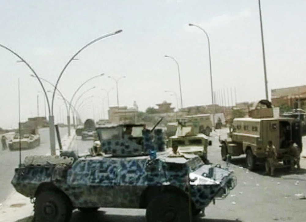 The Associated Press In image taken from video obtained from the Iraqi Military, armored and military vehicles take position on a street during clashes with militants in the northern city of Mosul, Iraq.