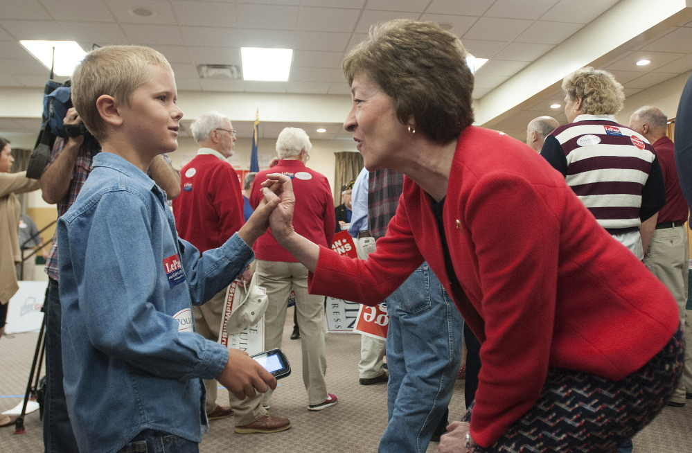 U.S. Sen. Susan Collins meets Isaiah Dunphy, 9, of Embden as she enters the Republican campaign kickoff on the Husson University campus in Bangor on Friday.