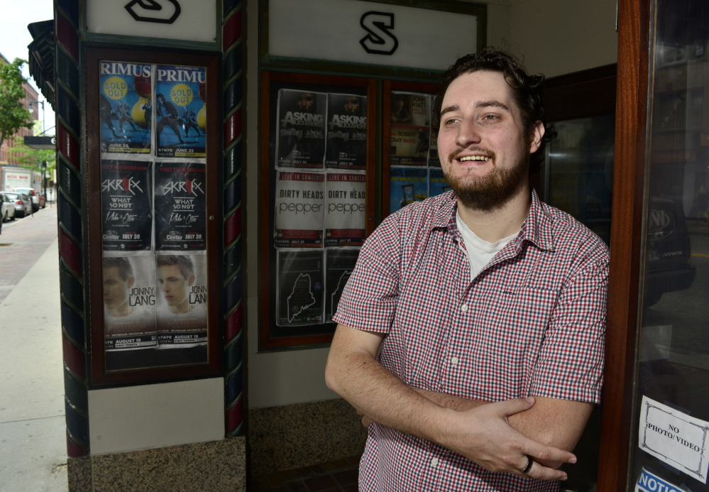 """Cody DeLong stands in front of the State Theatre in Portland on Wednesday. His company, Sound Rink, is growing as musicians look for ways to diversify their revenue streams. """"I could be anywhere, but I choose to be here,"""" he said."""