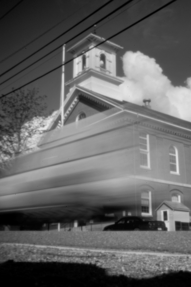 Captured in the aperture of a pinhole camera, a vehicle streaks past Washington County Courthouse in Machias recently. James Ellinwood, the only hunter in the group of five from Massachusetts to be charged in a violent altercation with the Passamaquoddy at Pleasant Point in 1965, was tried on a single count of manslaughter during his trial here. For Indians, the proceedings were a devastating experience.