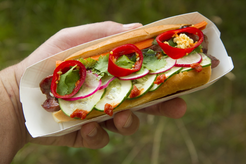 The Hot Dog Indochine features pickled carrot, radish, cilantro, basil, fresno chili, cucumber, citrus chili, mayo and hoisin.
