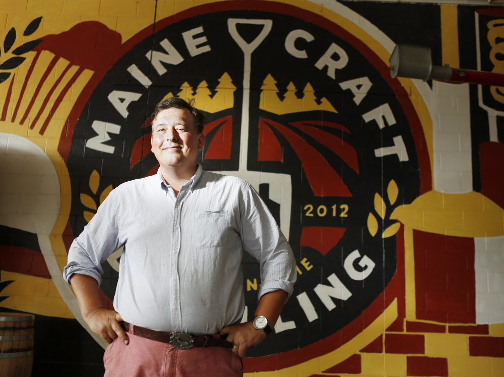 """Luke Davidson, a Maine native, owns Maine Craft Distilling in Portland. """"We call ourselves farm to flask, so we're trying to focus as much of the region as we can in the bottle,"""" he said."""