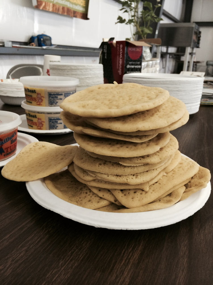 """Ployes are not flipped like pancakes. If you flip them, says Dumais, """"It means you've failed."""""""
