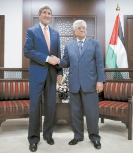U.S. SECRETARY OF STATE JOHN KERRY meets with Palestinian Authority President Mahmoud Abbas, right, in Ramallah in this July 23 file photo. It's a busy week in Mideast diplomacy, bookended by the launch of Israel-Hamas talks about a border deal for blockaded Gaza and the Palestinian president's U.N. speech scheduled for Friday, Sept. 26, about a new strategy for dealing with Israel.