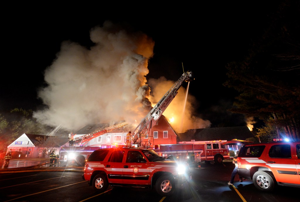 Firefighters battle a three-alarm fire Monday night at the Scarborough Commons commercial building at 153 Route 1.