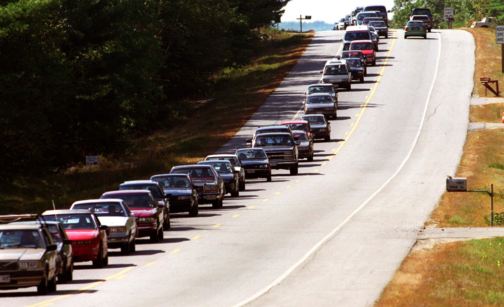 Traffic along Route 17 slows to a stand-still as people attempt to get to the Common Ground Fair in 2001. Things haven't changed. Cars idled for hours at this year's gate.