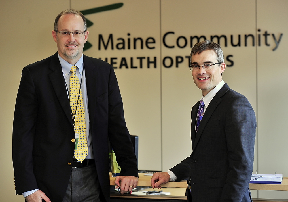 """Community Health Options CEO Kevin Lewis, right, seen with Chief Operating Officer Robert Hillman in 2013, said it wasn't an easy decision to drop abortion coverage, along with adult vision care, but both are """"non-essential health benefits"""" under the Affordable Care Act."""