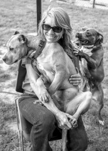 AIMEE SADLER TEACHES ANIMAL SHELTERS how to do play groups with their dogs in