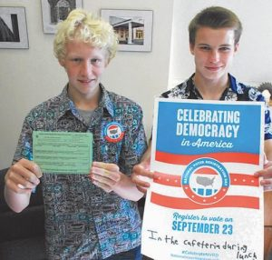 BRUNSWICK HIGH SCHOOL seniors Oliver Smith, left, and Eric Kousky are registering to vote, even though they won't be eligible to cast a ballot in November.